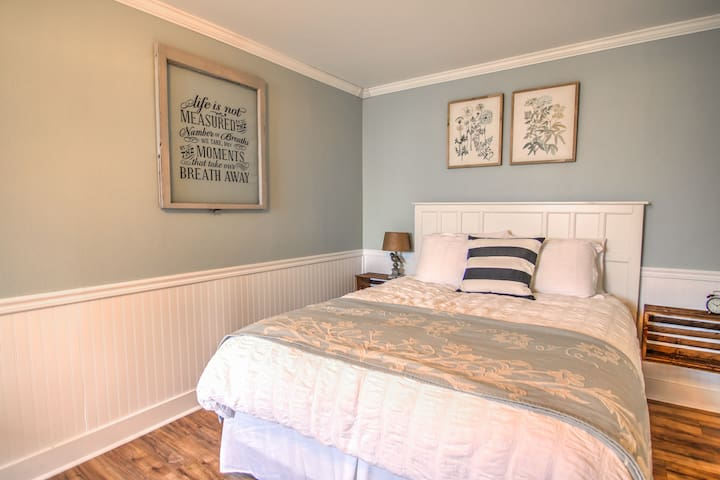 Queen bed in large bedroom offers retreat-like feel...