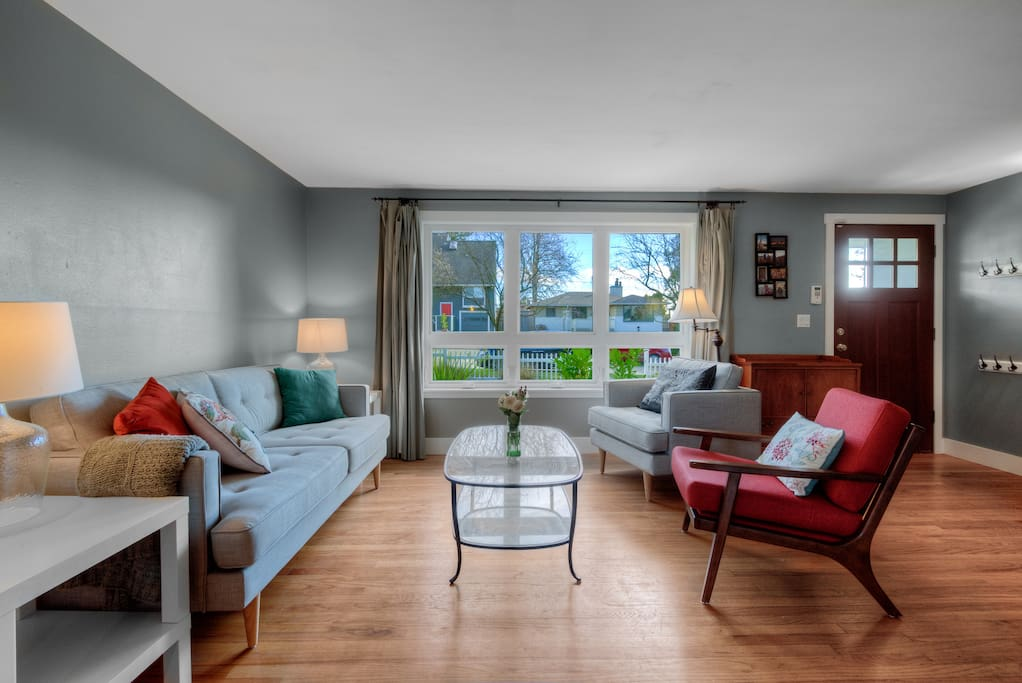 Front living room. View from 3 large front windows into front yard and street.
