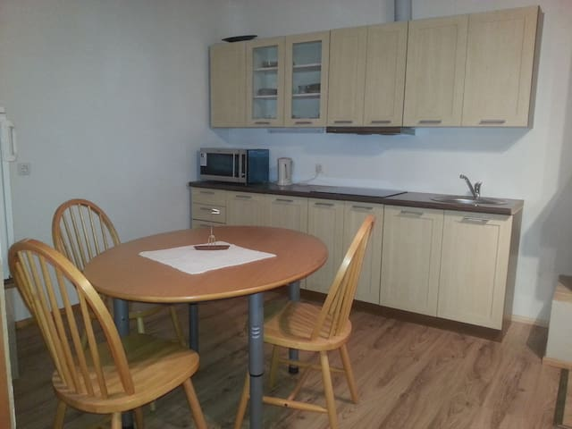 Kitchen have coffee machine, refrigerator, roaster, micro wave oven, water heater and all necessarily cooking tools and cutlery
