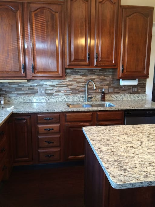 Cooks kitchen- dishwasher, microwave, granite counters, coffee center.