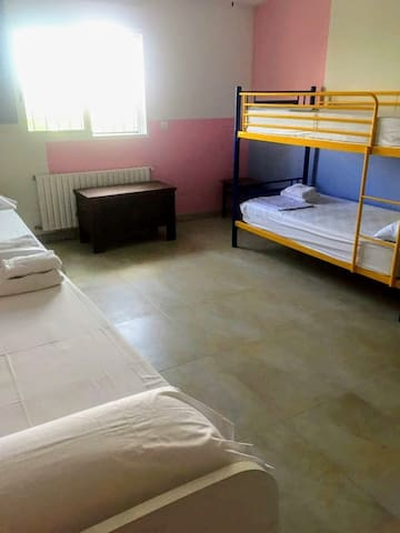 Bedroom 3 with 2 single beds and bunk bed