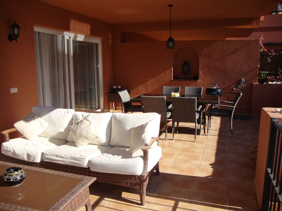 Lots of room to relax outside on the terrace, with direct access to the pool and gardens