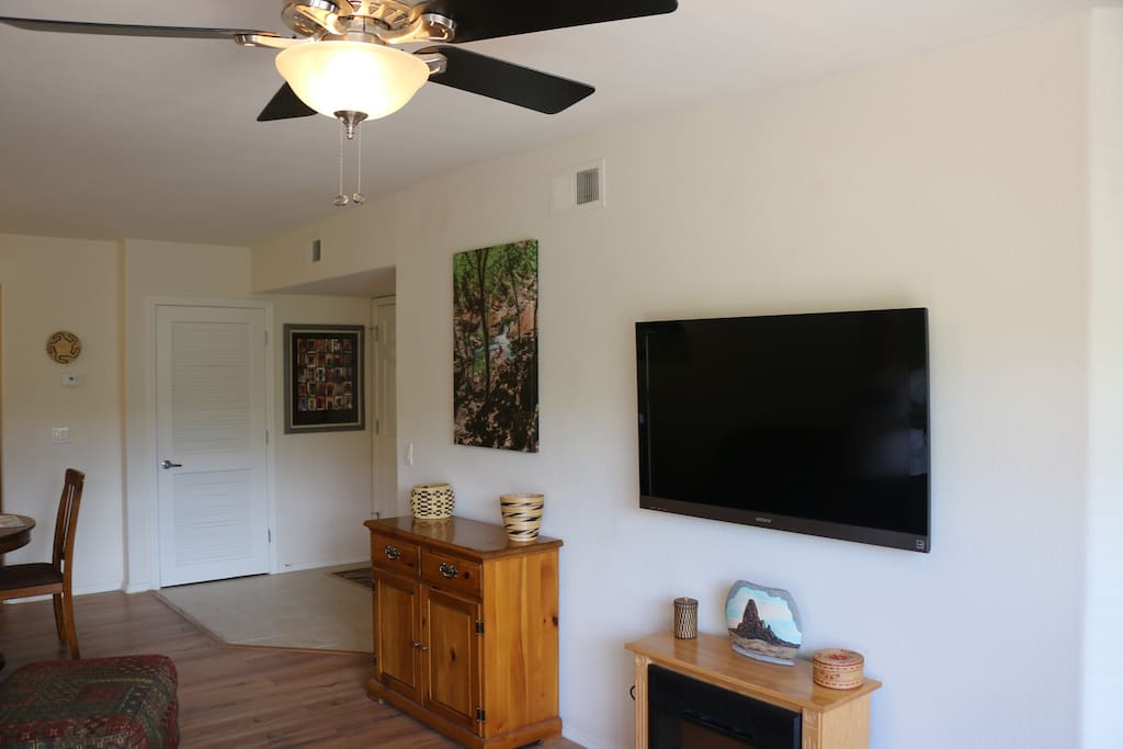 """50"""" HDTV over Electric Fireplace"""