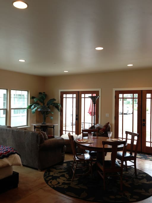 Double french doors lead to patio and backyard