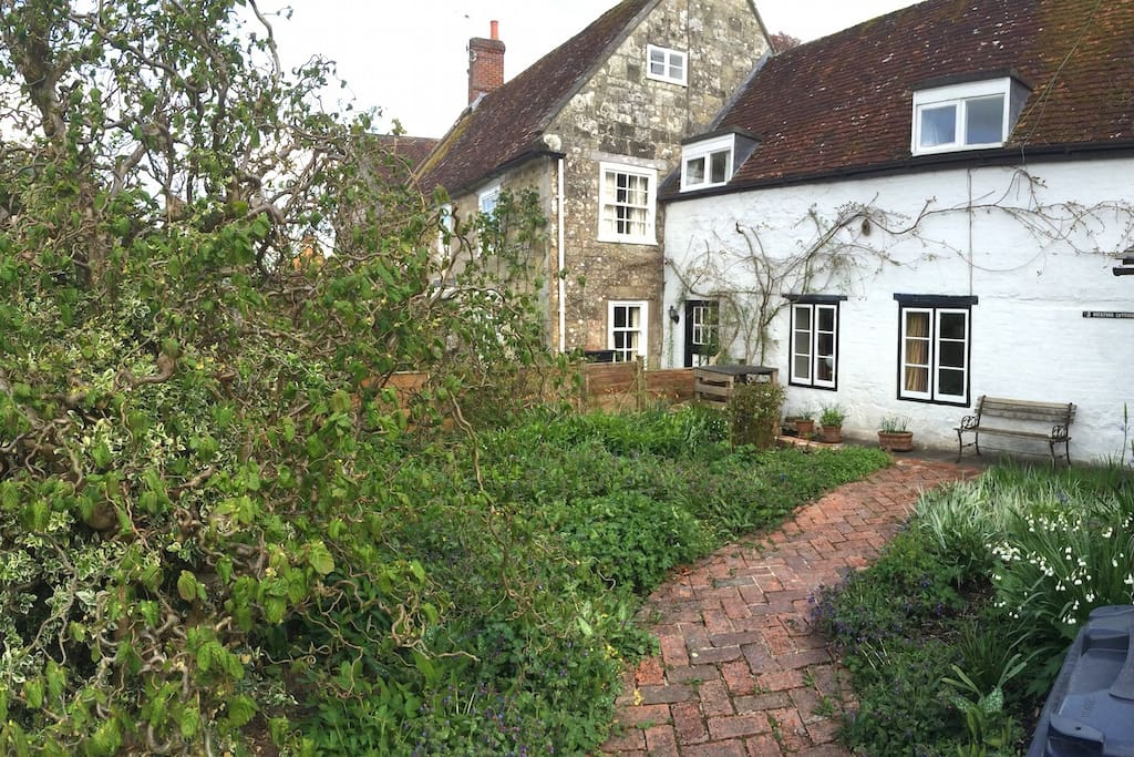 The old brick path and front of the cottage