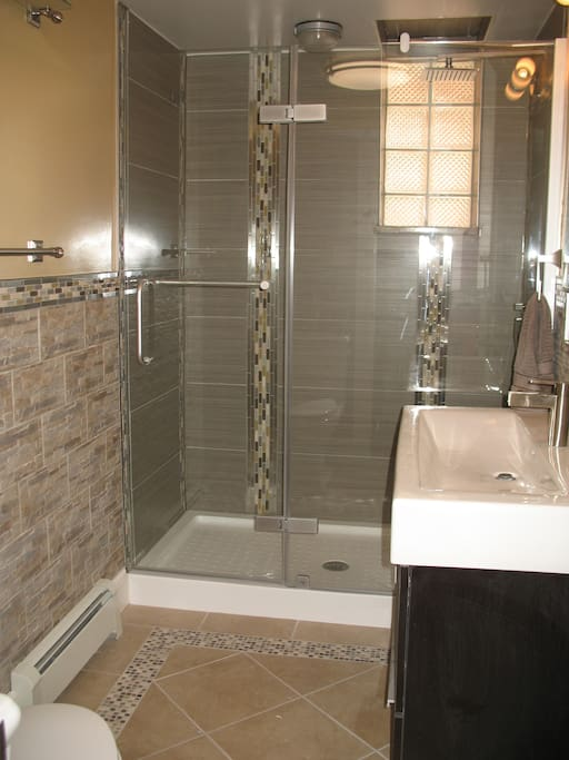 Beautiful Bathroom with Glassed-in Shower Enclosure