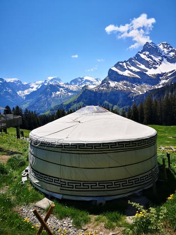 Yurt in imposing mountains