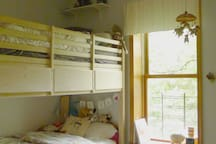 Bedroom with bunk beds and loads of children's books
