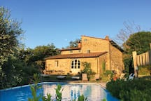 Surrounded by centuries-old oaks, olive groves and meadows, the ancient stone farmhouse lies nestled in the Chianti hills
