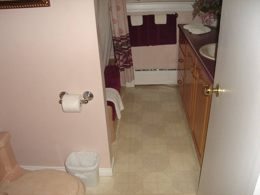 Oak cabinets, 3 mirror vanity, optional exhaust fan and a night light for those 3 am visits.