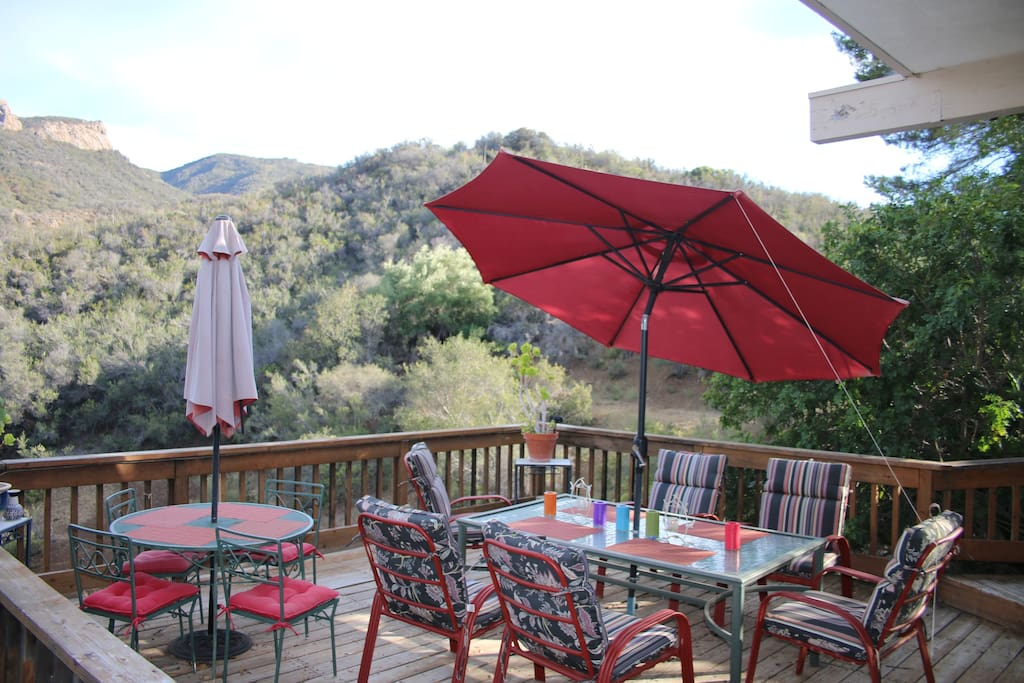 The deck is a peaceful place to enjoy breakfast or an evening glass of wine.