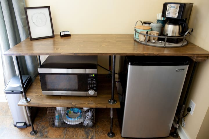 The kitchenette has a fridge and microwave as well as paper plates and plastic silverware to help you finish off those OBX leftovers.