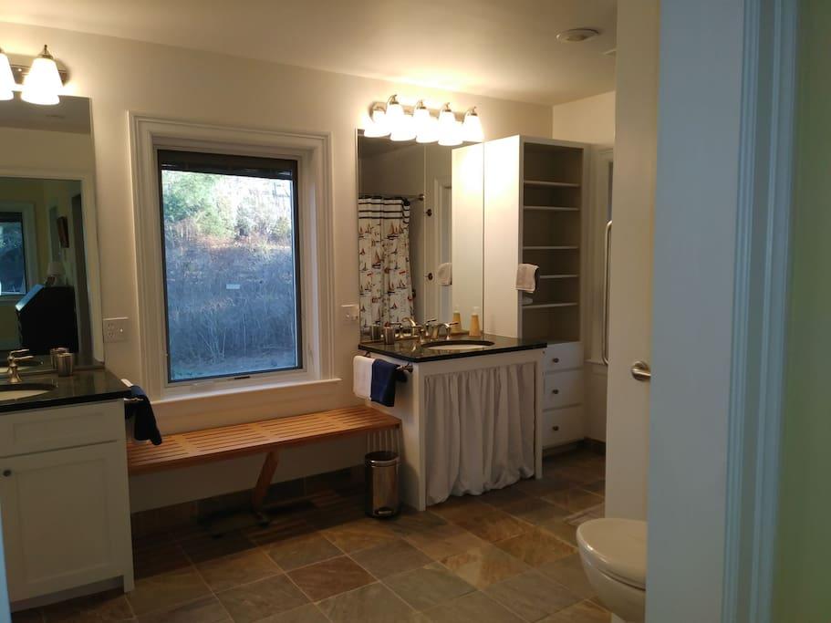 En-suite bathroom, with 2 separate vanities, large walk-in shower, handicap equipped, and spacious.