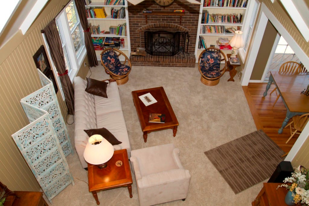 Cozy large 'schoolhouse' Family Room with wood-burning fireplace.