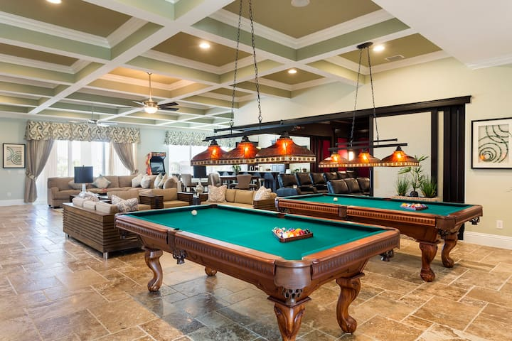Designed to provide the ultimate experience for families or corporate retreats.  Featuring two 8 foot billiards, TVs everywhere, seating for all and an incredible home theater that opens up.