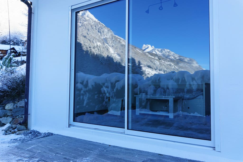 View into the studio with winter landscape reflecting