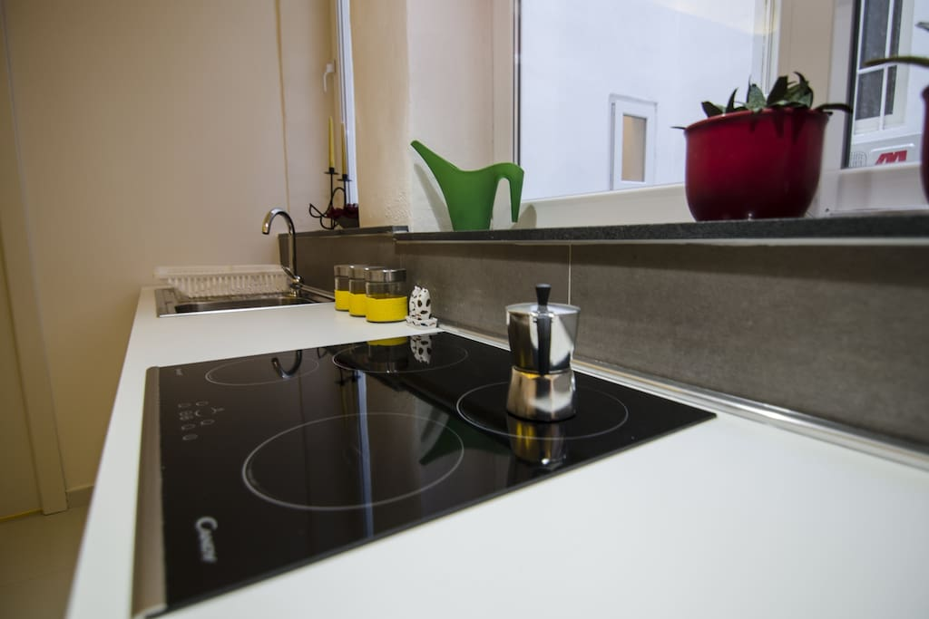 The kitchen is fully-equipped with dishwasher, fridge freezer, sink, cooker and hob