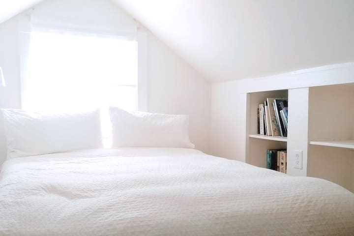 Loft bedroom is accessed by a ladder and has low ceilings. The bed has memory foam mattress with high quality 100% cotton linens, down comforter and down pillows.