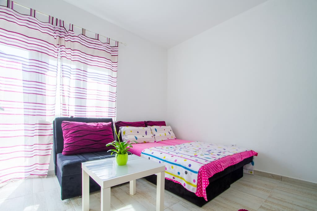 Queen Size Bed and Sofa suitable for accommodating 3 people.