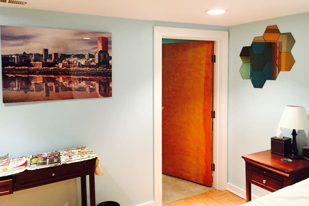 The bedroom door to the living room area.  Portland travel guides available.