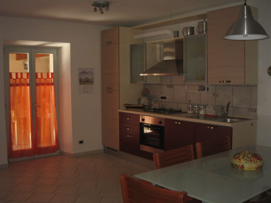 The spacious kitchen with access to terrace.