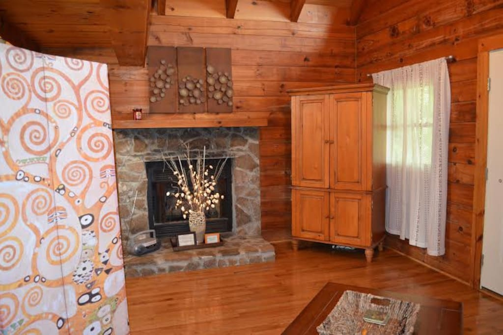 Beautiful stone fireplace.  Armoir with flat screen TV