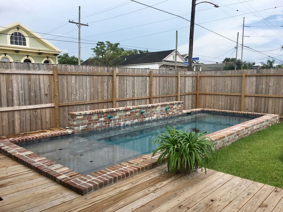 Pool and large deck on our corner double lot with gated off-street parking