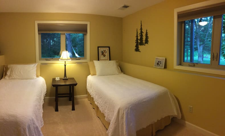 This is one of four rooms available.  It has two twin beds and a bathroom with shower across the hall.  The beds can also be set up as a king size, if preferred.