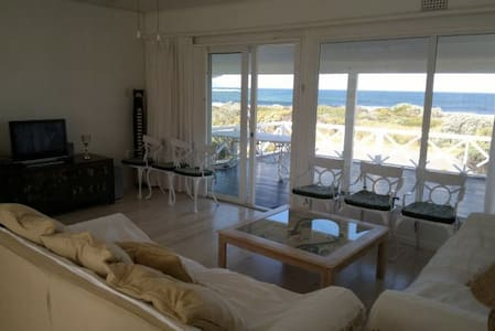 Seafront Beach Cottage with superb views