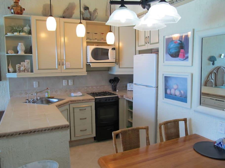 Full Kitchen, dishwasher, stove, oven and full size fridge