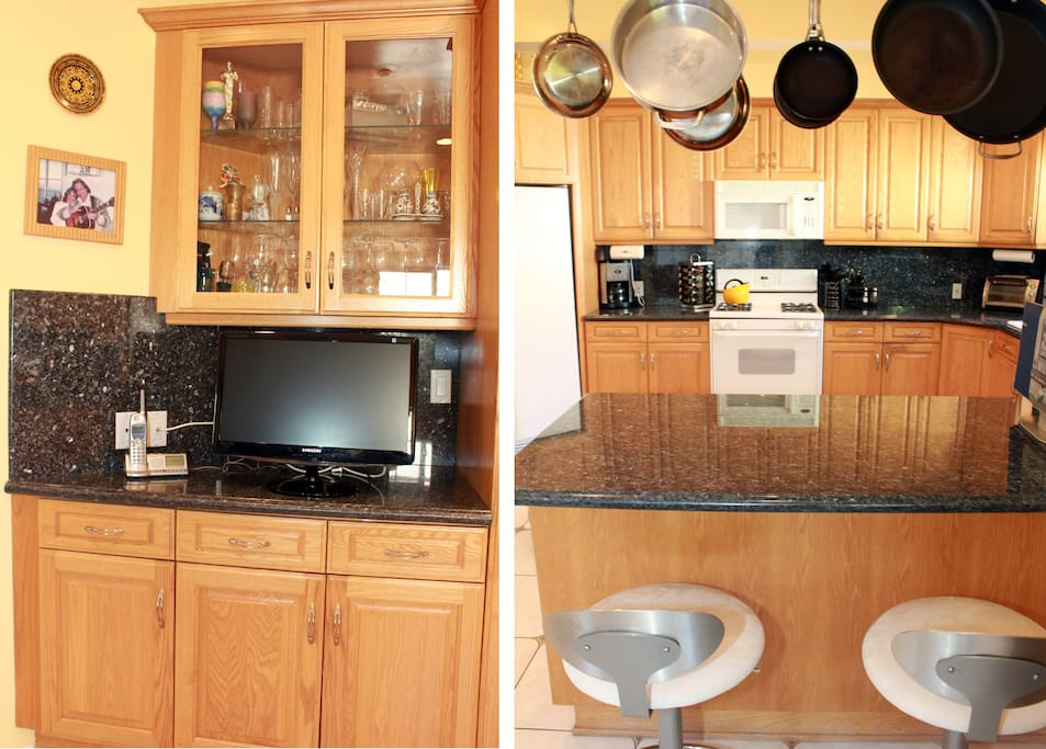 Island/bar with stools and TV in kitchen