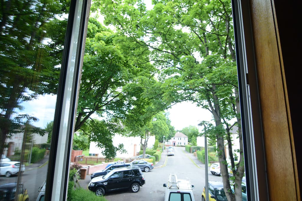 This is the view from your bedroom's window - it is a very quiet street full of beautiful trees