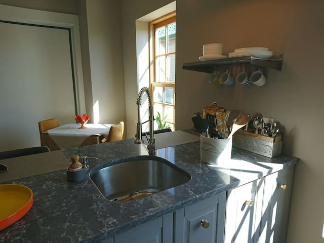 The kitchen also includes a dinette set with seating for two. The table can open up to make more room for you if needed. The dishes, flatware and cooking utensil are all easy access. We have included unpaper towels and napkins for Eco-friendly home.