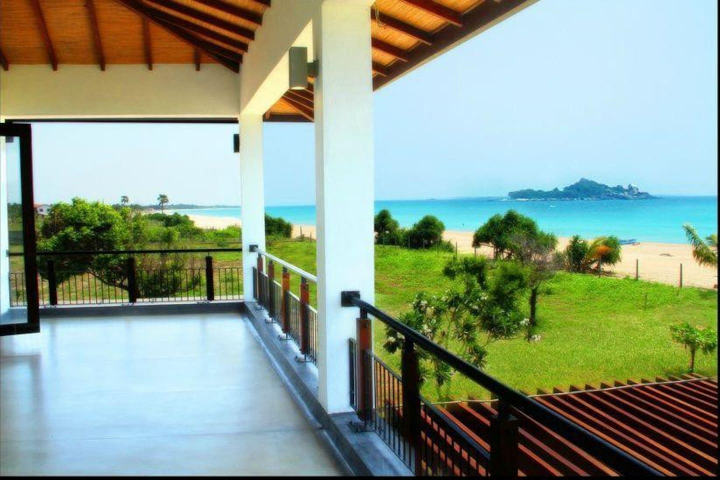 All The Rooms in the Villa will have an amazing view of the Ocean. The Pigeons Island is also visible from the Villa.  This Picture is taken from the 1st Floor Balcony; Which is equipped comfortable Outdoor Sofas for Lounging.
