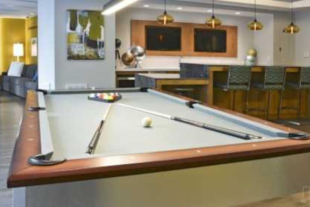 Shoot some pool in our clubhouse...