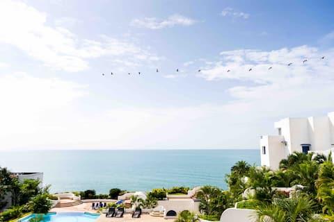Suite con excelente vista y cerca de la playa WIFI