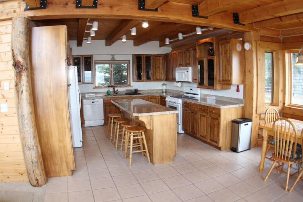 Fully stocked kitchen with beautiful finishes and classic cabin decor