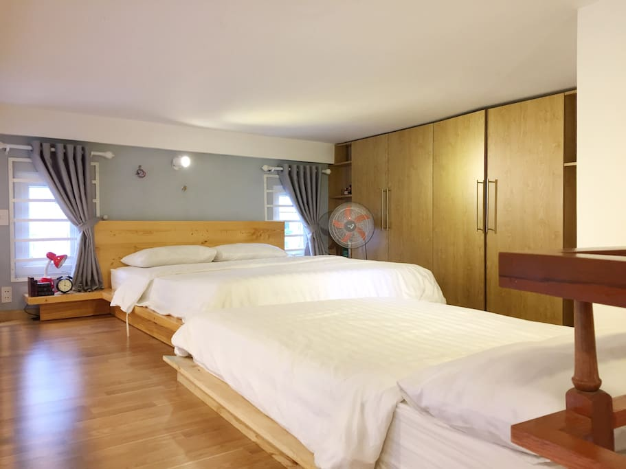Comfortable beds on mezzanine.