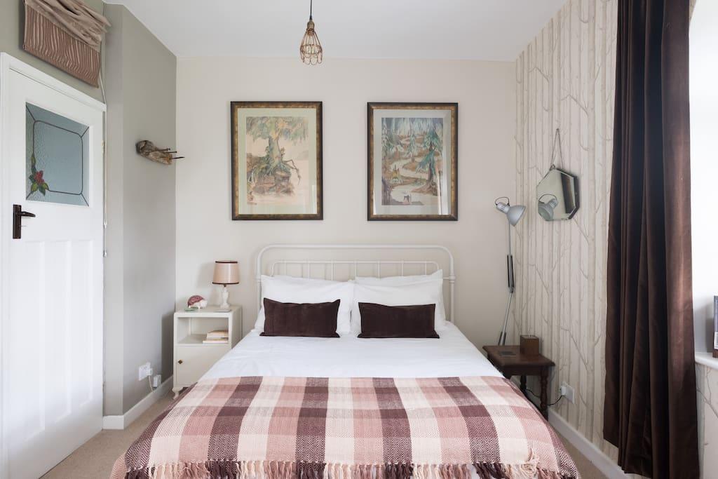 Woodland themed room in calm neutrals. Hotel grade bedding,