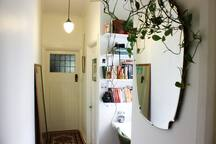 Small study nook in the hallway with a laptop for guest use