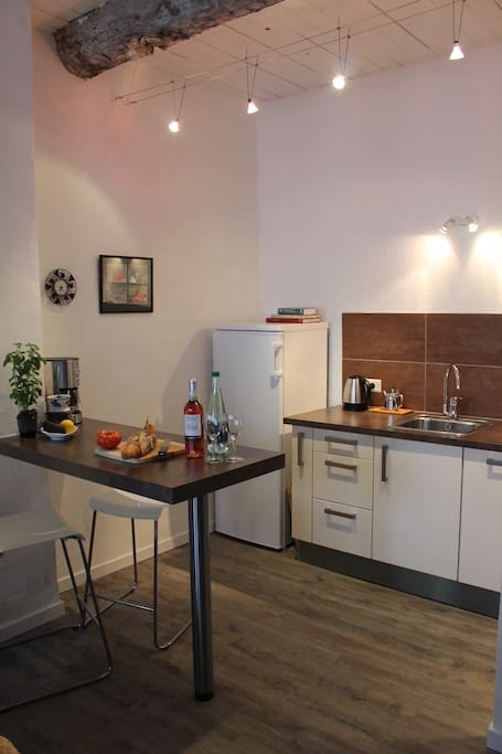 Open plan kitchen with integrated dishwasher