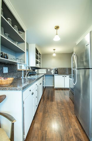 Kitchen with stainless steel appliances, including dishwasher