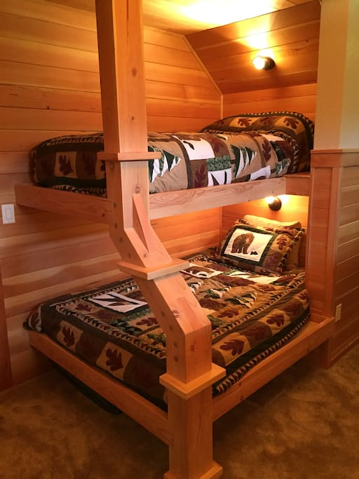 One set of bunks has a larger lower bunk that can sleep two people.