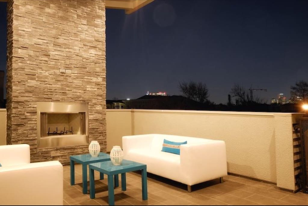 Third floor covered balcony with gas fireplace has a spectacular view of downtown Houston and always has a breeze plus a ceiling fan to keep you cool. For chilly winter nights turn on the fireplace and get cozy with blankets