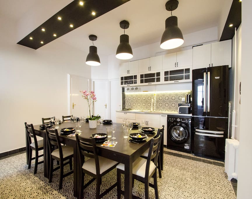 the apartment's dining table and area is big enough for even a group of 10 to sit down