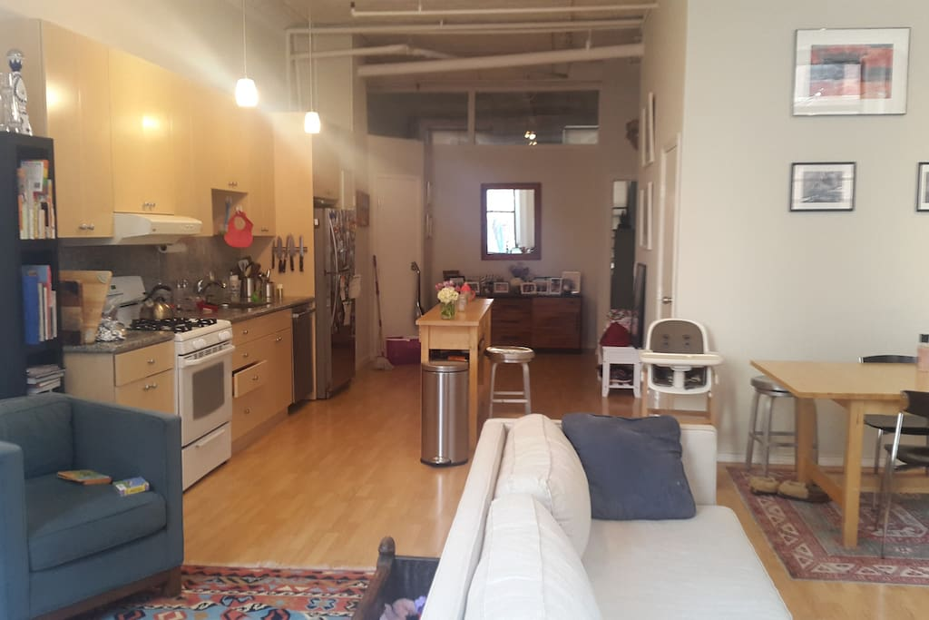Walk through kitchen with gas stove, oven, dishwasher and refrigerator