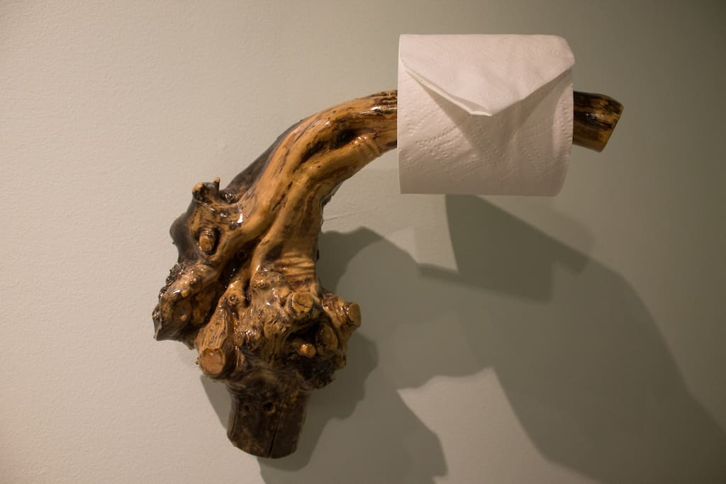 Lilac root toilet paper holder.