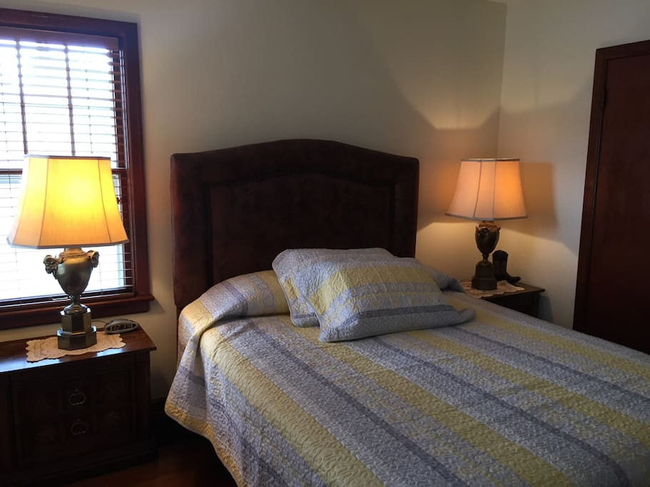 queen bed in master bedroom with flat screen television