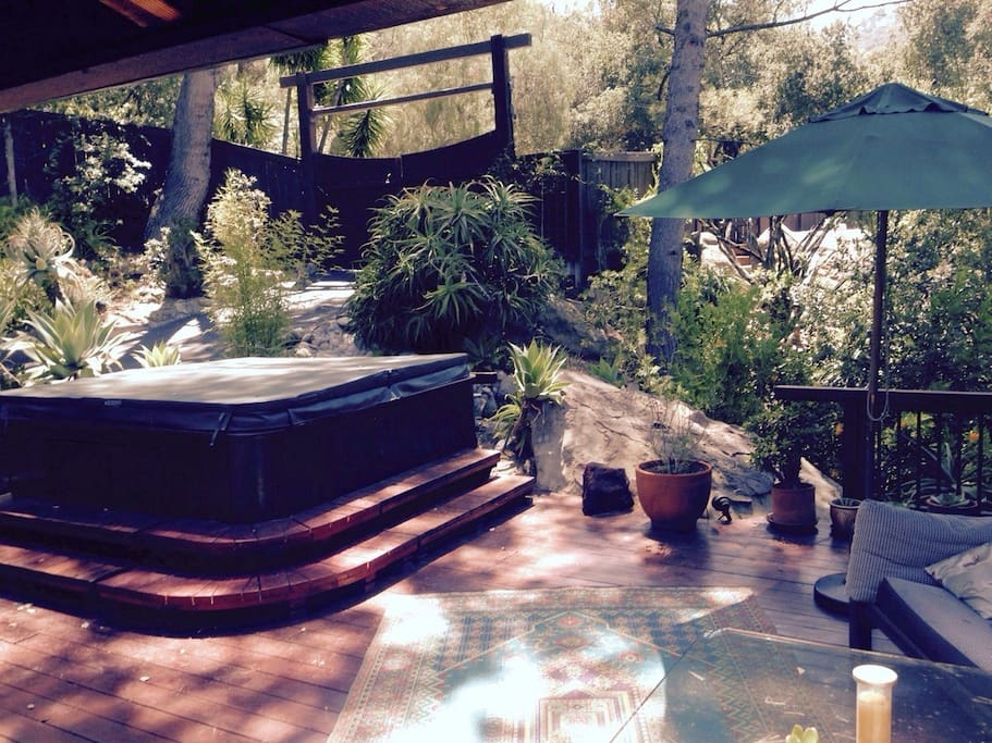 Hot tub on a front deck for relaxing Jacuzzi hydrotherapy