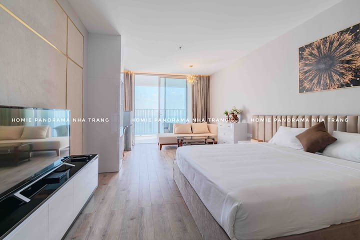 The bedroom where you can enjoy the beautiful sea view from everywhere in the room.